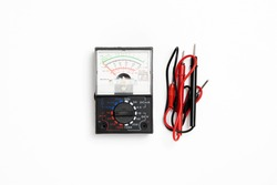 Black digital multimeter electronic measurement device tool with red and black cables isolated on white background.High resolution photo.