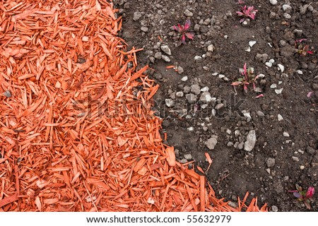 Black dirt and red mulch background