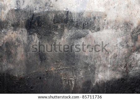 black dirt (dust) on white wall, grunge background