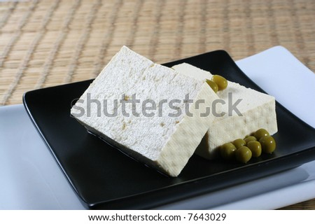 Black dish with tofu