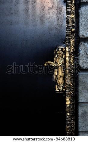 black door with golden...