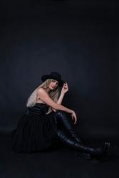 black dressed model girl with a black hat