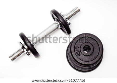 Black dumbbell, bodybuilding equipment isolated on white background. Fitness concept