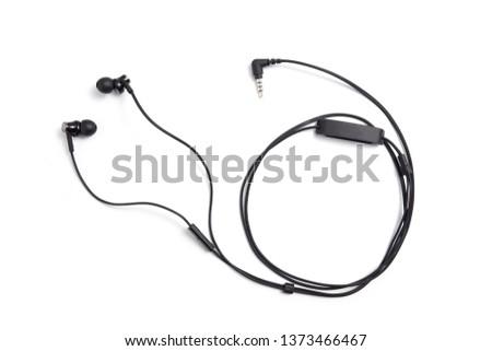 Black earphone in white background