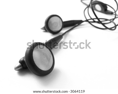 black earphones from mobile phone on the white background