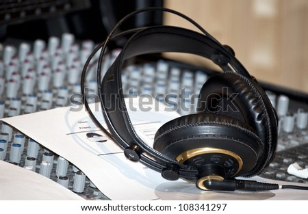 black earphones on a console in a recording studio