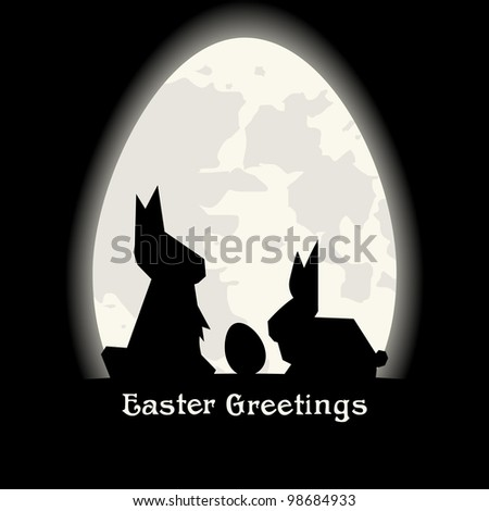 Black Easter Greetings with origami bunny silhouette in front of the Moon like egg.