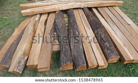 Black ebony  fence's rot-proof posts heap, ready to be plown.
