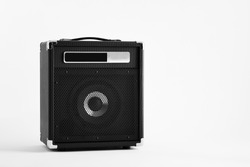 Black electric guitar bass amplifier or amp on white background.
