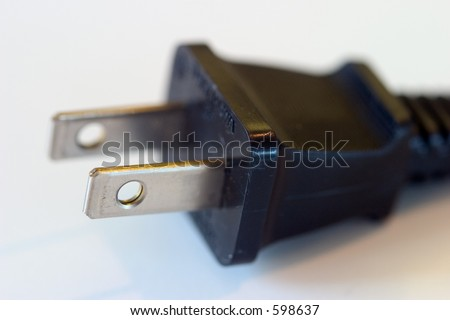 Black electrical plug, no ground prong, macro with a shallow dof.