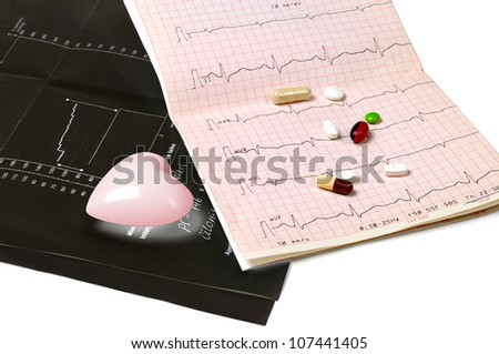 Black electrocardiogram, tablets and heart on white