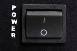 Black electronic On-Off switch front of power amplifier, stock image