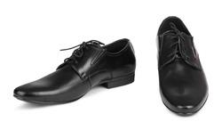 Black elegant men's shoes on white isolated background