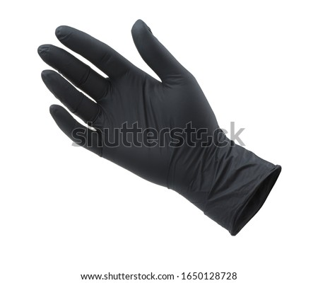 Photo of  Black empty nitrile protective glove isolated on white