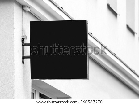 Black empty outdoor business signage mock up to add company logo #560587270