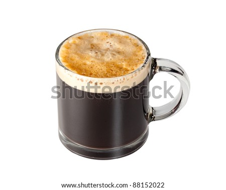 Black espresso coffee with heady froth in a glass mug or cup with path around the edge