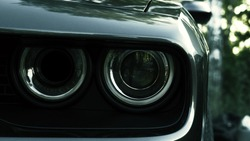 Black expensive musclecar close up front view