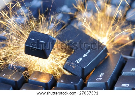 Black exploding computer keyboard with electric sparks.