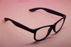 black eye glasses isolated on pink background