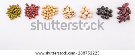 Black eye peas, mung bean, adzuki beans, soy beans, black beans and red kidney beans on white background