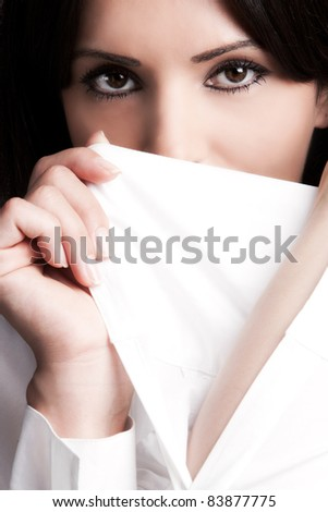 black eyes woman face behind perfect white sleeve, close up, studio shot