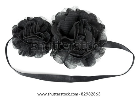 black fabric flower with crystals isolated on a white background
