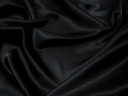Black fabric texture background, wavy fabric slippery black color, luxury satin cloth texture.