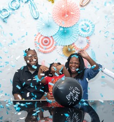 Black family at a gender reveal baby shower