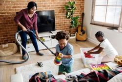Black family cleaning the house together