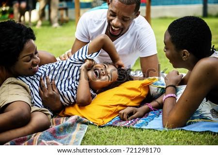 Black family enjoying summer together at backyard