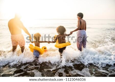Black family having fun on the beach
