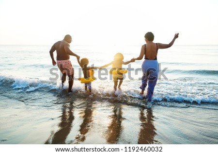 Black family having fun on the beach