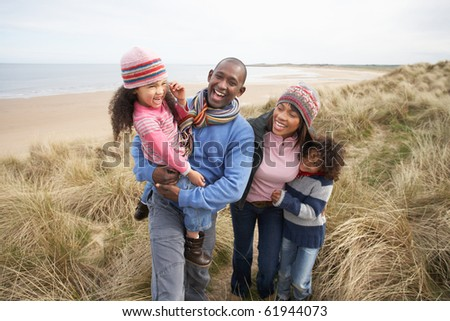 Black Family on a beach - stock photo