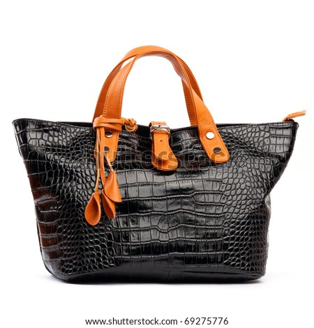 Black female bag with orange handles on white background - stock photo