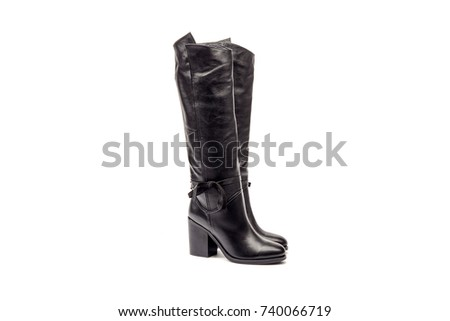 Shutterstock Black female boots isolated on white background.