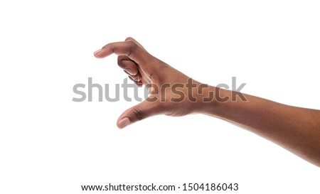 Black female hand measuring invisible items, showing small amount of something, or holding virtual smartphone, isolated on white background. Panorama with copy space