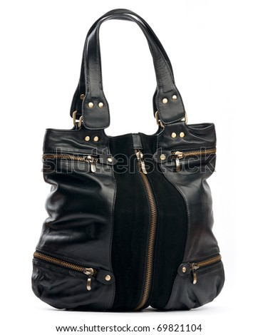 Black female handbag with zippers over white background