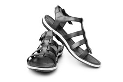 Black female sandals on white background isolated closeup front view, stylish woman sandal shoes with straps, pair of fashion leather summer sandals, two boots, casual walking footwear, urban footgear
