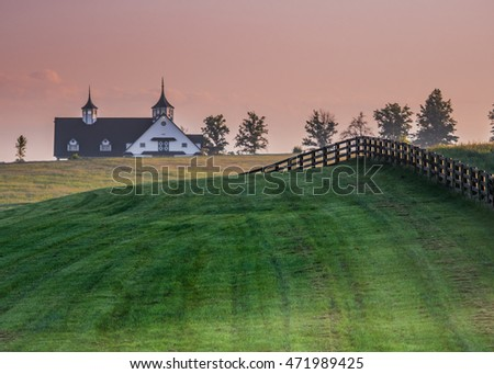 Black Fence Leads over the Hill in Kentucky horse country #471989425