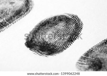 Black fingerprint on white background. Friction ridge pattern #1399062248