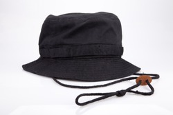 Black fishing hat on a white surface. Fishing ht isolated on white background.