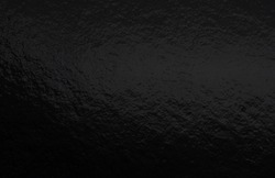 Black foil gradient texture background with uneven surface