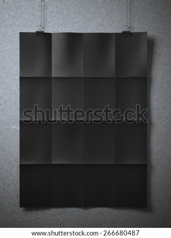 Black folded  sheet of paper