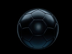 Black football or soccer ball on a matching black background with highlight on the textured surface and copy space
