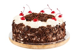 Black forest cake decorated with whipped cream and cherries. Isolated on white background