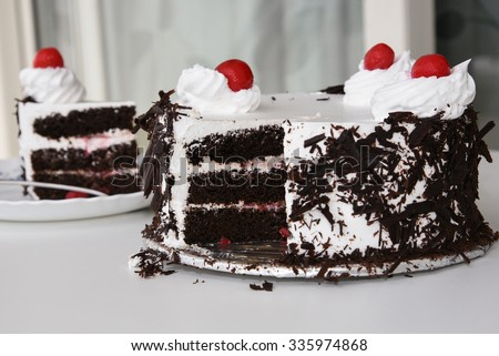 Black forest cake decorated with whipped cream and cherries. Isolated on white background. piece of cake. Girl cutting a cake for Christmas. Christmas cake
