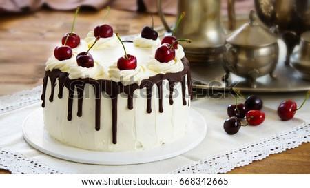 Black forest cake, Schwarzwälder Kirschtorte, Schwarzwald pie, dark chocolate and cherry dessert on wooden background