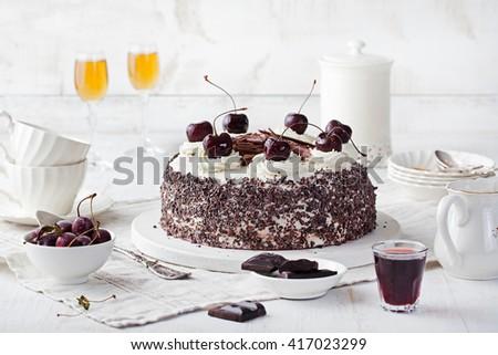 Black forest cake, Schwarzwald pie, dark chocolate and cherry dessert on a white plate