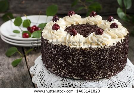 Black forest cake, Schwarzwald pie, dark chocolate and cherry dessert on wooden background