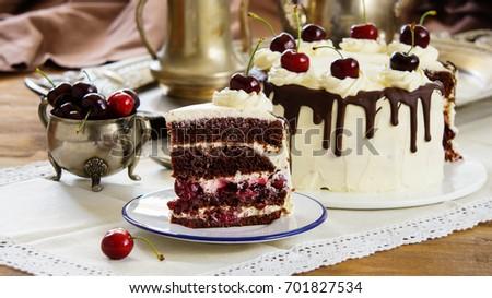Black forest cake, Schwarzwalder Kirschtorte, Schwarzwald pie, dark chocolate and cherry dessert on wooden background